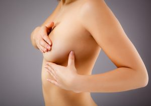 Female Torso Holding Left Breast With Hands